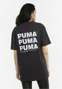 Puma - Print T-shirt - black - 2