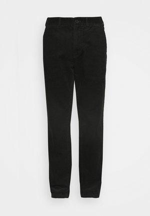 CHINO - Trousers - khaki green dark