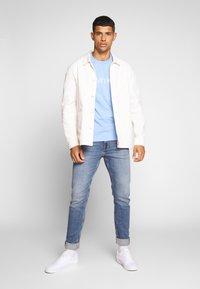 Calvin Klein Jeans - SLIM TAPER - Slim fit jeans - dark blue - 1