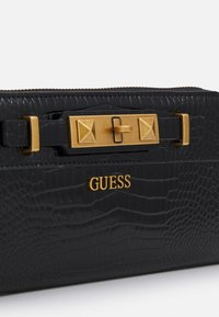 Guess - RAFFIE LARGE ZIP AROUND - Wallet - black - 4