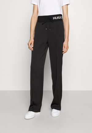 HASISI - Spodnie treningowe - black