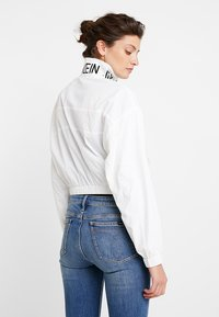 Calvin Klein Jeans - LOGO TAPE  - Winter jacket - bright white - 2