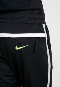 Nike Sportswear - M NSW NIKE AIR PANT PK - Spodnie treningowe - black/smoke grey - 4