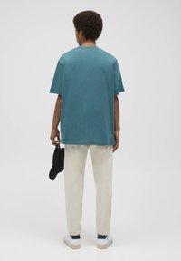 PULL&BEAR - Print T-shirt - mottled dark green - 2