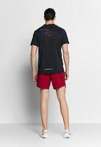 Nike Performance - RISE HYBRID - Print T-shirt - black - 2