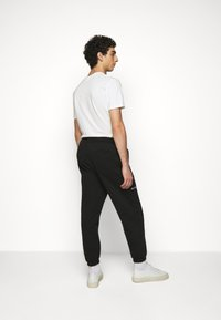 Han Kjøbenhavn - PANTS - Tracksuit bottoms - black - 2