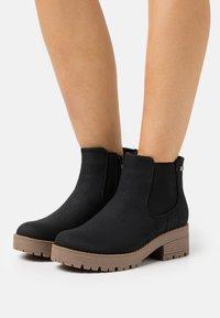 Anna Field - Kotníkové boty na platformě - black - 0