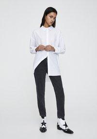 PULL&BEAR - Slim fit jeans - mottled dark grey - 1