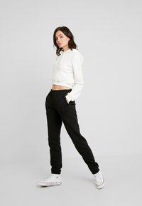 Nly by Nelly - COZY PANTS - Tracksuit bottoms - black - 1