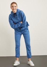 DeFacto Fit - Tracksuit bottoms - blue - 1