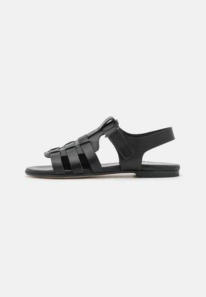 OUTSOLE - Sandaalit nilkkaremmillä - nero