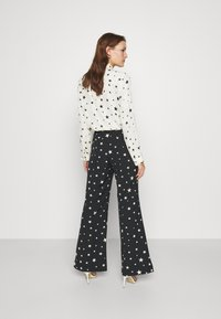 Fabienne Chapot - PUCK TROUSER - Trousers - black/warm white - 2