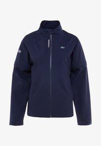 Lacoste Sport - HIGH PERFORMANCE JACKET 2 IN 1 - Outdoorová bunda - navy blue/white - 7