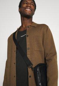 Calvin Klein Jeans - MICRO BRANDING TANK - Top - black - 3