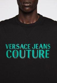 Versace Jeans Couture - LOGO - T-shirt imprimé - black - 9