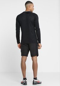 Nike Performance - DRY ACADEMY SHORT - Sports shorts - black/white - 2