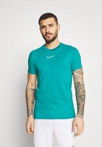 Nike Performance - DRY - T-shirt con stampa - aquamarine/white - 2