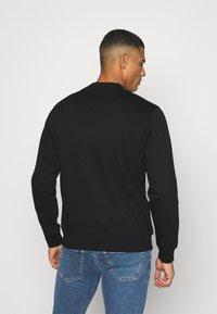Calvin Klein Jeans - SHINY MONOGRAM CREW NECK UNISEX - Sweatshirt - black - 2
