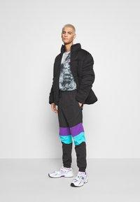 Urban Classics - CRINKLE TRACK PANTS - Tracksuit bottoms - black/ultraviolet/aqua - 1