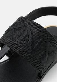 DKNY - AMBER SLINGBACK FLAT THONG - T-bar sandals - black/shiny black - 6