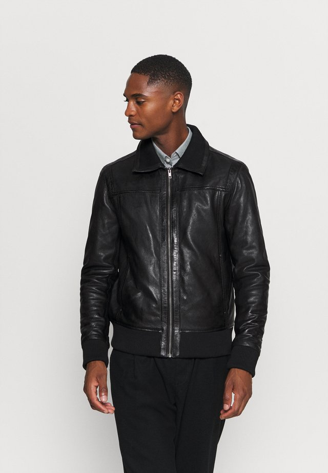 KEATON - Leather jacket - black