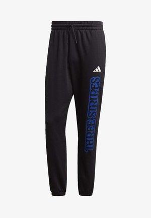 STRIPES GRAPHIC JOGGERS - Pantalones deportivos - black