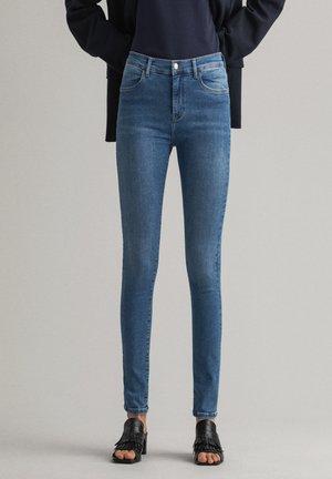 NELLA - Jeans slim fit - semi light blue broken in