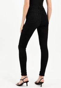 TALLY WEiJL - Jeans Skinny Fit - black - 2