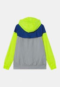 Nike Sportswear - Training jacket - light smoke grey/game royal/volt - 1