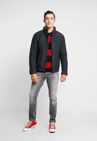 Calvin Klein Jeans - PADDED HOOD ZIP THROUGH - Light jacket - black - 1
