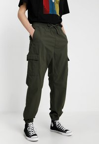 Carhartt WIP - JOGGER COLUMBIA - Cargo trousers - cypress rinsed - 0