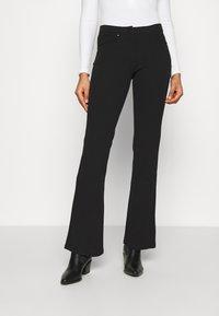 JDY - JDYCATIA FLARE - Trousers - black - 0