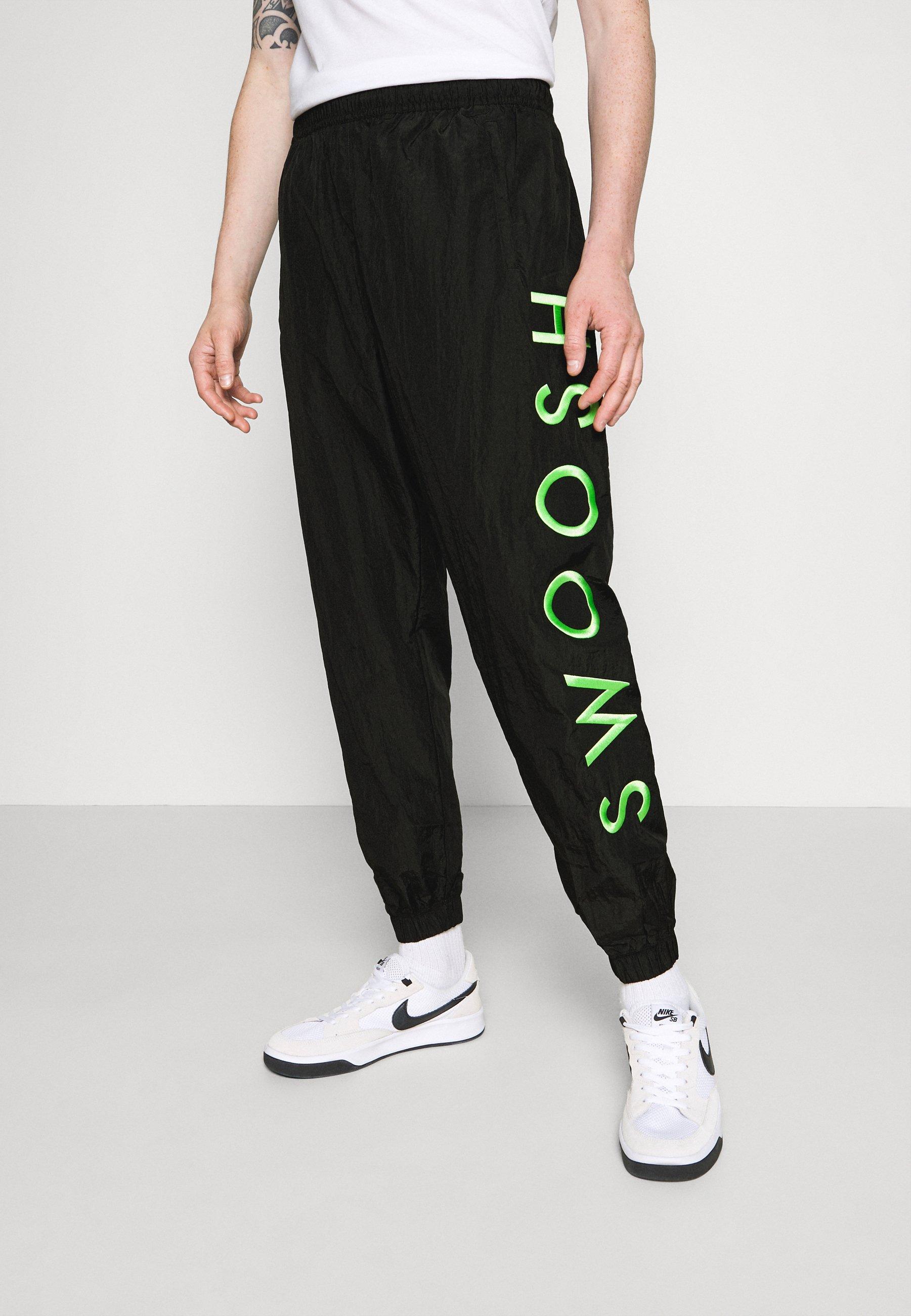 balsa Federal Permuta  Nike Sportswear PANT - Pantalon de survêtement - black/green/noir -  ZALANDO.FR