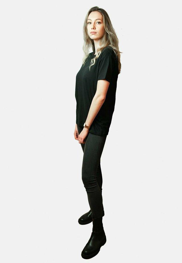 FLOAT BACK UNISEX - T-shirt med print - black