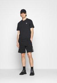 adidas Originals - ESSENTIAL TEE - Jednoduché triko - black - 1
