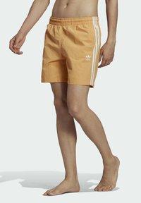 adidas Originals - ADICOLOR CLASSICS 3-STRIPES SWIM SHORTS - Shorts da mare - orange - 2