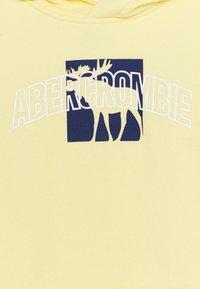 Abercrombie & Fitch - PRINT LOGO - Sudadera - pale yellow - 2
