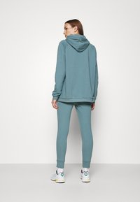 CALANDO - Tracksuit bottoms - turquoise - 2