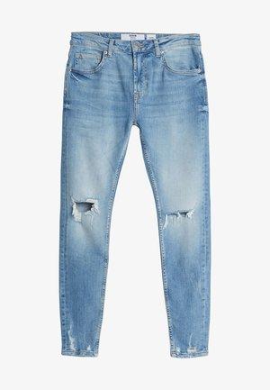 MIT RISSEN - Slim fit jeans - blue denim