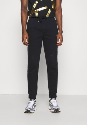 GOLD LOGO SWEATPANTS - Pantaloni sportivi - black