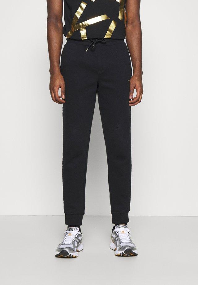 GOLD LOGO SWEATPANTS - Teplákové kalhoty - black