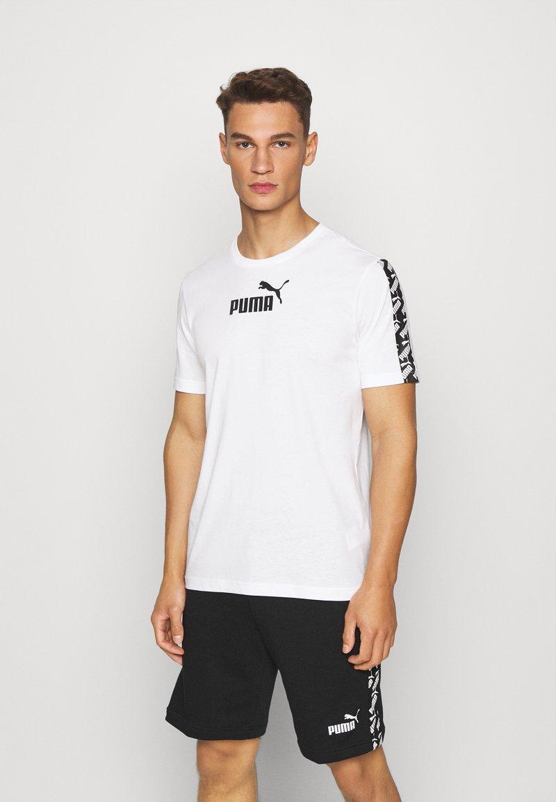 Puma - AMPLIFIED TEE - Print T-shirt - white