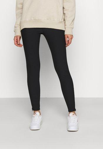 SIDE ZIP - Leggings - Trousers - black