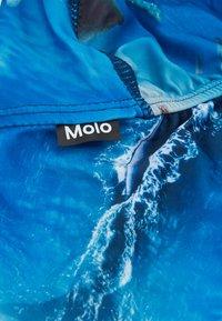 Molo - NANDO UNISEX - Hat - above ocean - 2