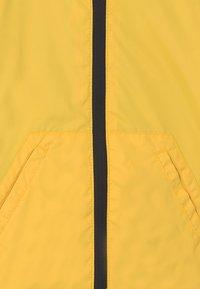 OVS - RAIN UNISEX - Waterproof jacket - blazing yellow - 2