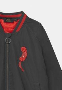 Mini Rodini - E.T. REFLECTIVE BASEBALL  UNISEX  - Winter jacket - black - 2