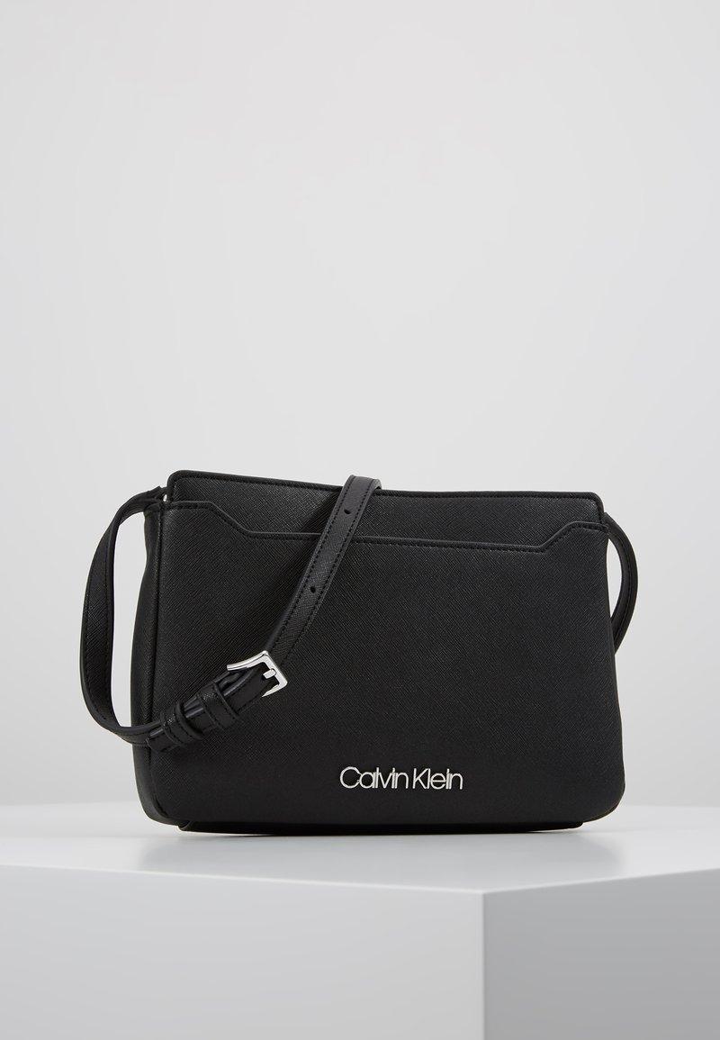 Calvin Klein - TASK XBODY - Taška spříčným popruhem - black