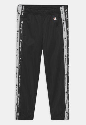 AMERICAN TAPE ELASTIC CUFF PANTS UNISEX - Pantalon de survêtement - black
