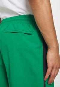 Reebok Classic - 2020-04-01 CLASSICS TWIN VECTOR TRACK PANTS - Tracksuit bottoms - green - 4