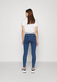 Calvin Klein Jeans - HIGH RISE SUPER SKINNY - Jeans Skinny Fit - dark blue - 2